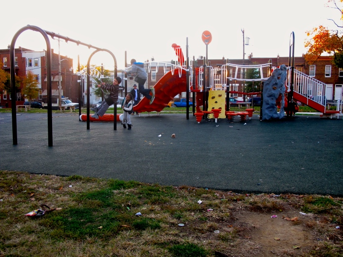 Despite a large community effort to clean up Needle Park, children play on its jungle gym until dark when the area is reclaimed by drug addicts.