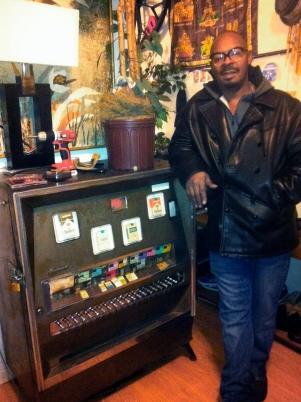 Robinson stores the profits from his no-questions-asked retail store inside an antique cigarette machine in his apartment.